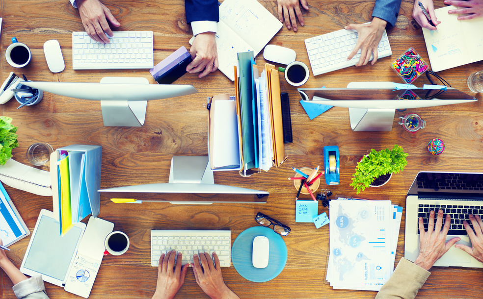 Group of Business People Working on an Office Desk