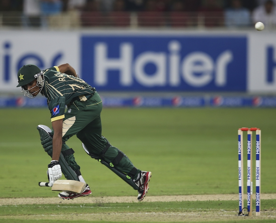Pakistani batsman Raza Hasan scrambles to make his ground during the International T20 match between Australia and Pakistan in Dubai, United Arab Emirates, Sunday, Oct. 5, 2014. (AP Photo/Kamran Jebreili)