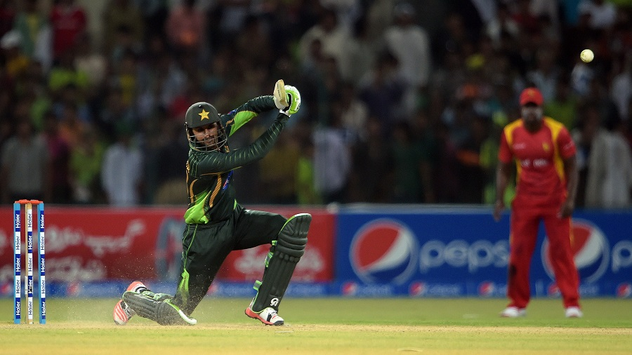 Pakistani batsman Shoaib Malik (L) plays a shot during the first one day international cricket match between Pakistan and Zimbabwe at the Gaddafi Cricket Stadium in Lahore on May 26, 2015. Pakistan rode on a brilliant hundred by Shoaib Malik to post their highest 375-3 run total against Zimbabwe in the first one-day international. AFP PHOTO / AAMIR QURESHI        (Photo credit should read AAMIR QURESHI/AFP/Getty Images)