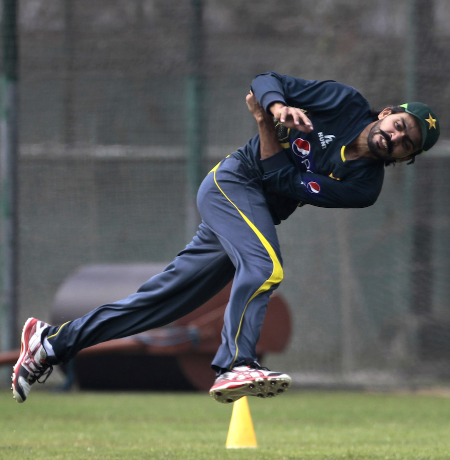 Pakistan's Fawad Alam throws a ball  during a practice session ahead of the Asia Cup tournament in Dhaka, Bangladesh, Sunday, Feb. 23, 2014. Pakistan plays Sri Lanka in the opening match of the five nation one day cricket event that begins Tuesday.(AP Photo/A.M. Ahad)