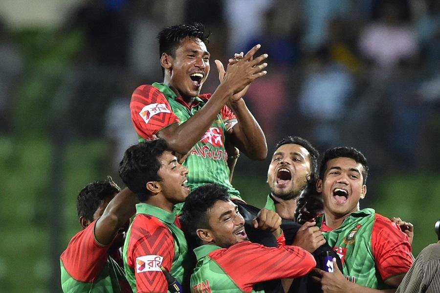 Bangladesh cricketer Mustafizur Rahman (top) is lifted by his teammates after winning the second ODI (One Day International) cricket match between Bangladesh and India at the Sher-e-Bangla National Cricket Stadium in Dhaka on June 21, 2015. AFP PHOTO/Munir uz ZAMAN        (Photo credit should read MUNIR UZ ZAMAN/AFP/Getty Images)