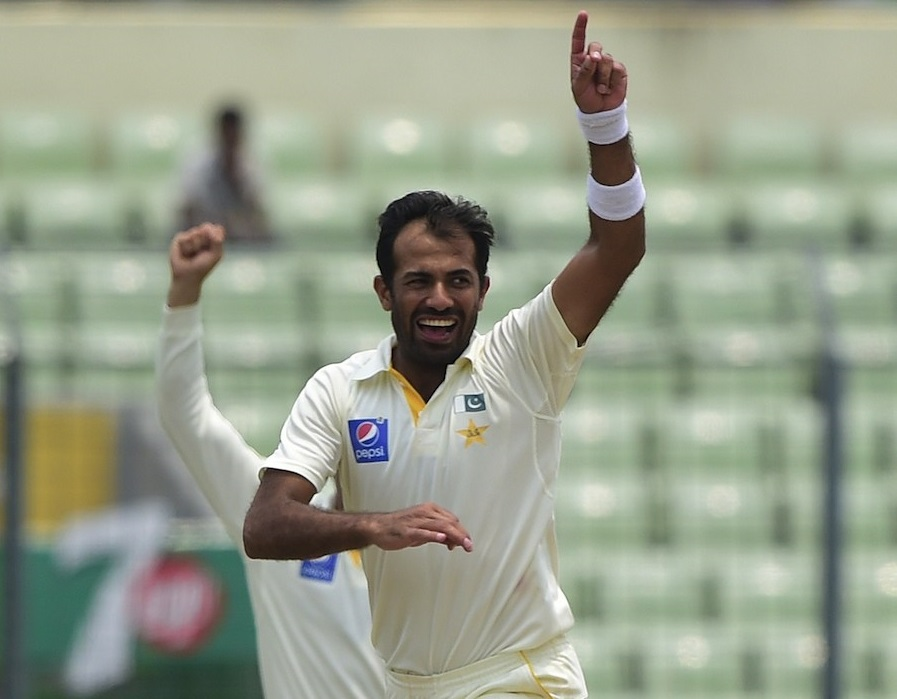 Pakistan cricketer Wahab Riaz reacts after the dismissal of the Bangladesh cricketer Soumya Sarkar during the fourth day of the second cricket Test match between Bangladesh and Pakistan at the Sher-e-Bangla National Cricket Stadium in Dhaka on May 9, 2015. AFP PHOTO/ Munir uz ZAMAN        (Photo credit should read MUNIR UZ ZAMAN/AFP/Getty Images)
