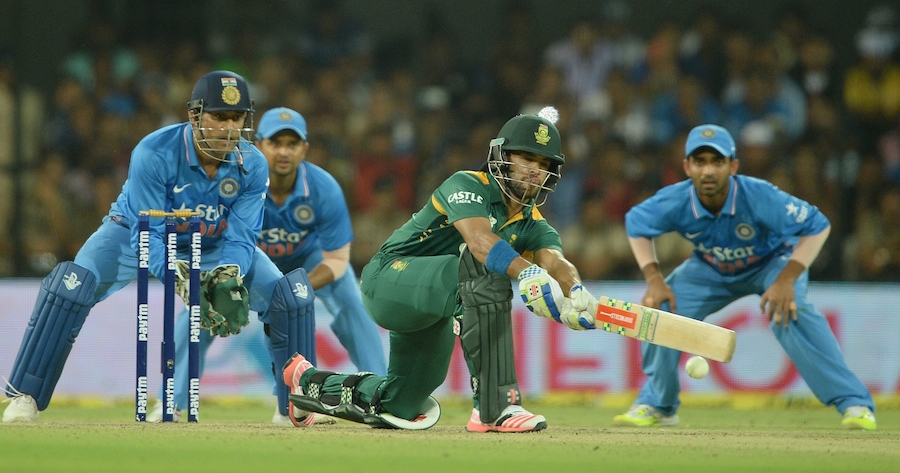 India's captain Mahendra Singh Dhoni (L) along with teammates Suresh Raina (2L) and Ajinkya Rahane (R) look on as South Africa's JP Duminy plays a shot during the second one day international (ODI) cricket match between India and South Africa at The Holkar Cricket Stadium at Indore on October 14, 2015. AFP PHOTO/ INDRANIL MUKHERJEE ----IMAGE RESTRICTED TO EDITORIAL USE - STRICTLY NO COMMERCIAL USE---        (Photo credit should read INDRANIL MUKHERJEE/AFP/Getty Images)